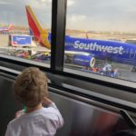 Child looking out airport window best and worst airlines southwest