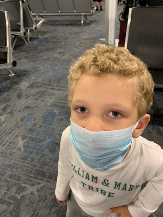 Child wearing face mask at airport in Orlando