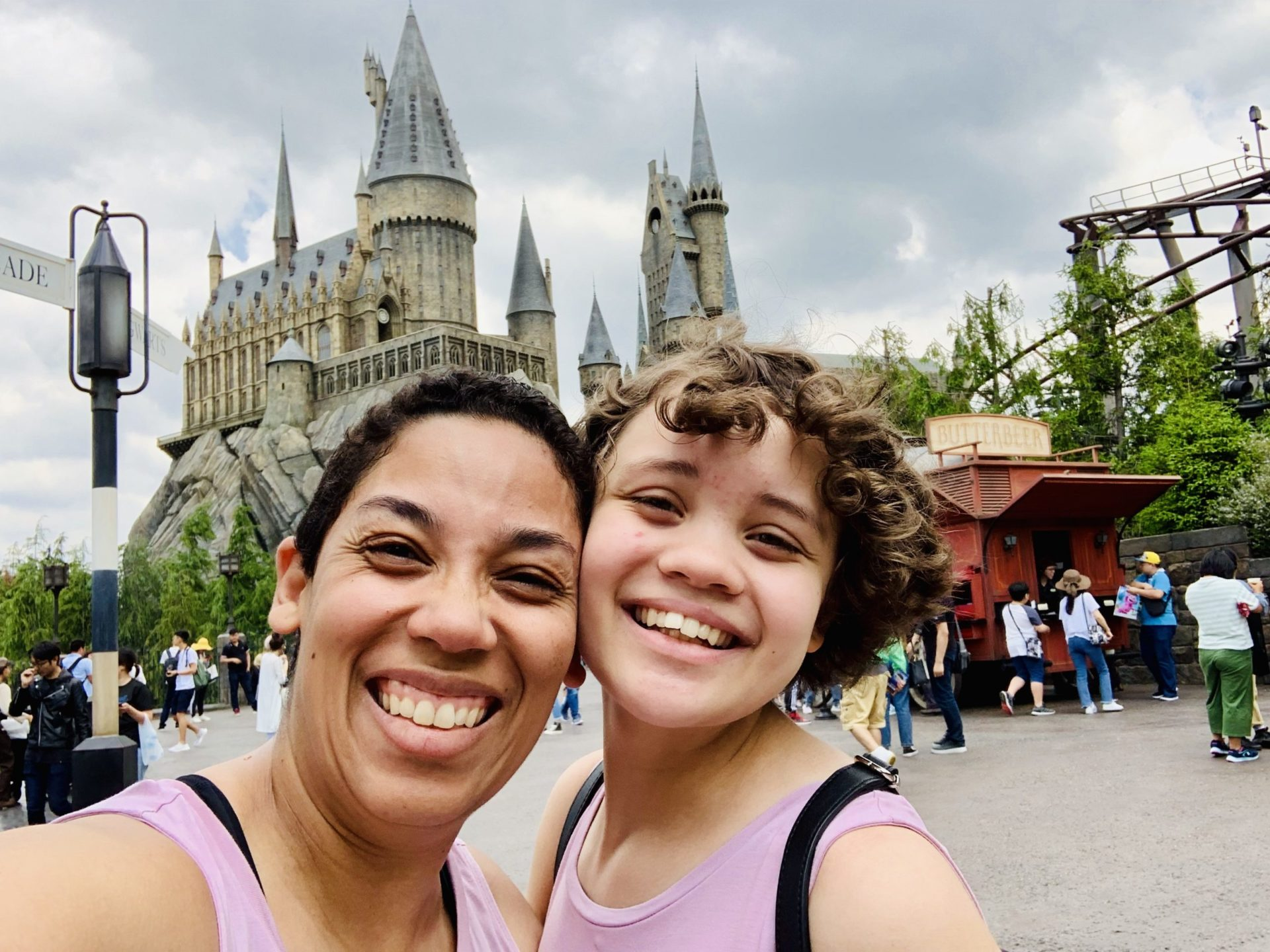 Two women standing outside Hogwarts castle at Universal Japan