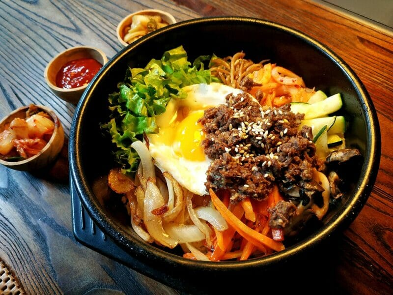 Bowl of steamed rice with vegetables, beef, and egg bibimbap