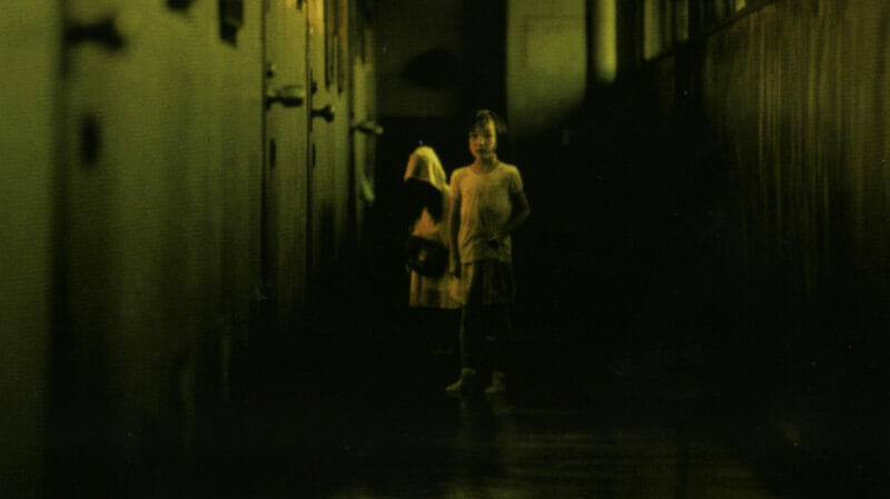 Girl and ghost in the hallway in Dark Water Japanese movie