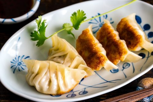 Plate of gyoza Japanese appetizers for a crowd