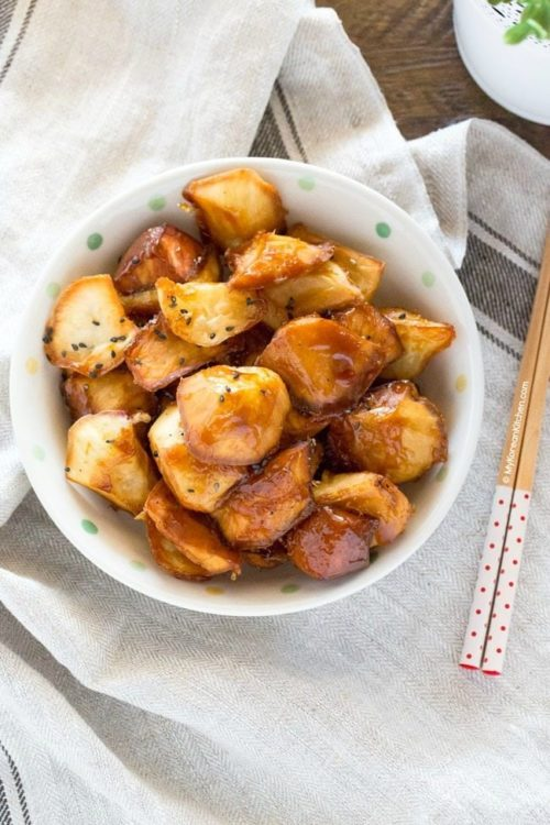 Korean candied sweet potato bowl with chopsticks