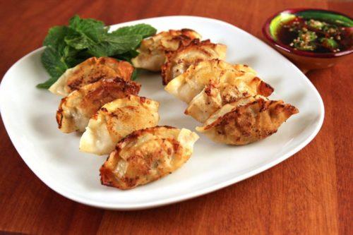 Korean mandu dumplings pot tickers on a white plate